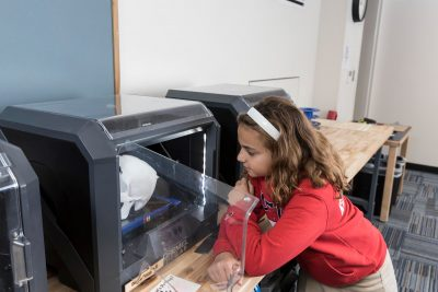 Kid working on 3D printer