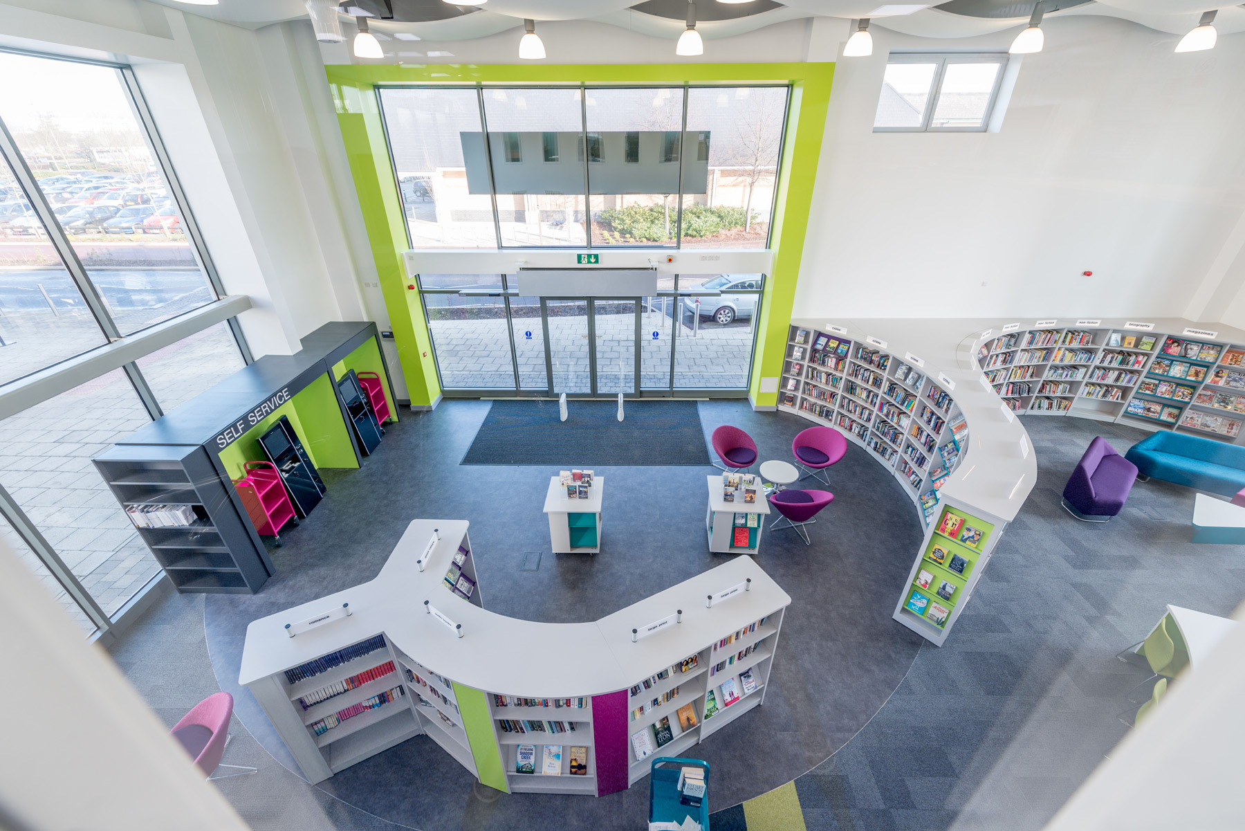 Kingston Library UK Custom Curved Shelving Draws Visitors Into The Space